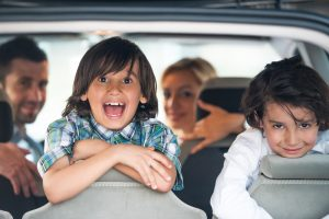 cheerful kids in car
