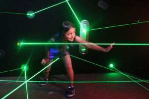Child playing laser maze game