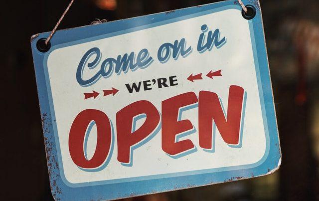 Retro open sign hanging on door
