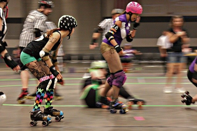 Roller derby girls skating during bout