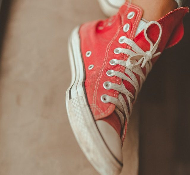 Red and white sneakers with tied laces